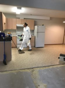 Picture of WFTS Staff cleaning up a contaminated unit progress
